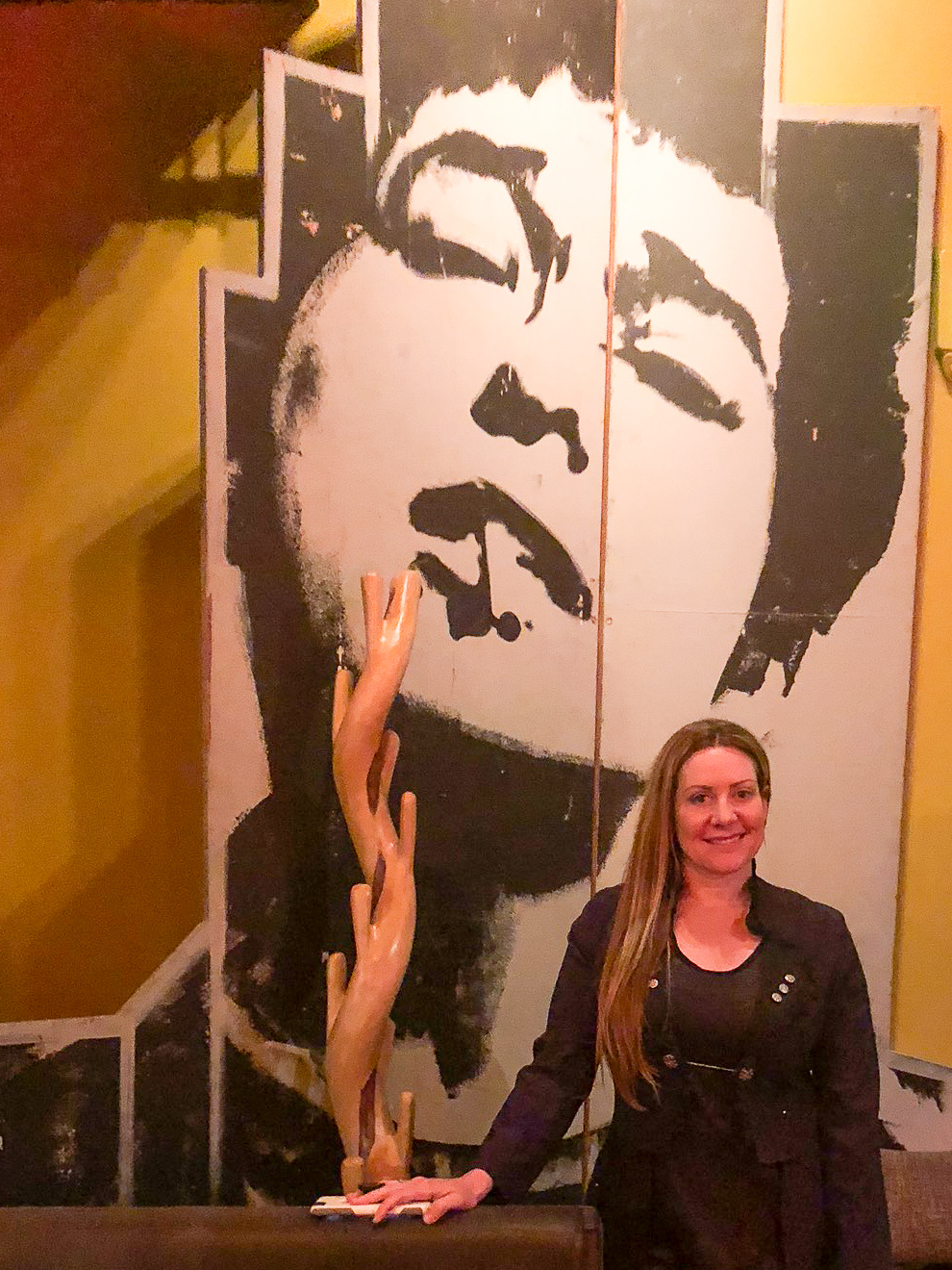 In front of the iconic Bob Dylan mural at The Carlisle Room in Seattle.
